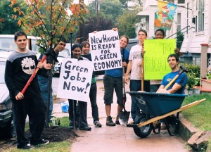 Green Jobs Corps students do environmental work around the city. Here they hold signs supporting green job opportunities.