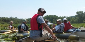 LEAF interns do water preservation and study work from canoes.