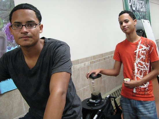Common Ground students Joshua Cintron and Nelson Ruiz on a pedal-powered smoothie-maker.