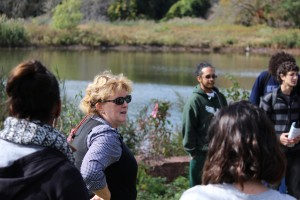 Environmental Justice students, with science teacher Tricia Johnson, explore water quality issues on the West River.