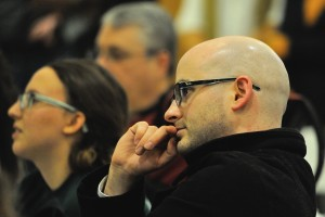 Common Ground English teacher Keith Lambert listens to testimony at the hearing. Photo by Mel Morales.