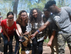 Giana, Francesca, Stephanie, Angel, and Freddie pose with a dog from the Paws 'N Effect program.