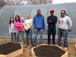 Common Ground students -- members of our School Garden Resource Center crew -- stand beside raised beds they've just constructed at a home-based child care provider. Health leadership among high school students lead to healthy eating among young children.