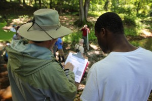 Science Teacher Dave Edgeworth and Tyreek, a member of the West River Stewards, join in a training on stream surveys. This past summer, the Stewards surveyed Wintergreen Brook from its headwaters to the confluence of with the West River.