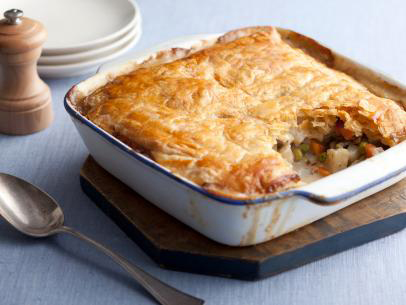 A photo of a vegetable pot pie on a cutting board.
