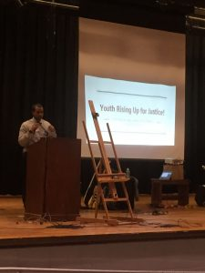 Nate Wilson speaking at the Earth Day Youth Summit at Hillhouse High School.