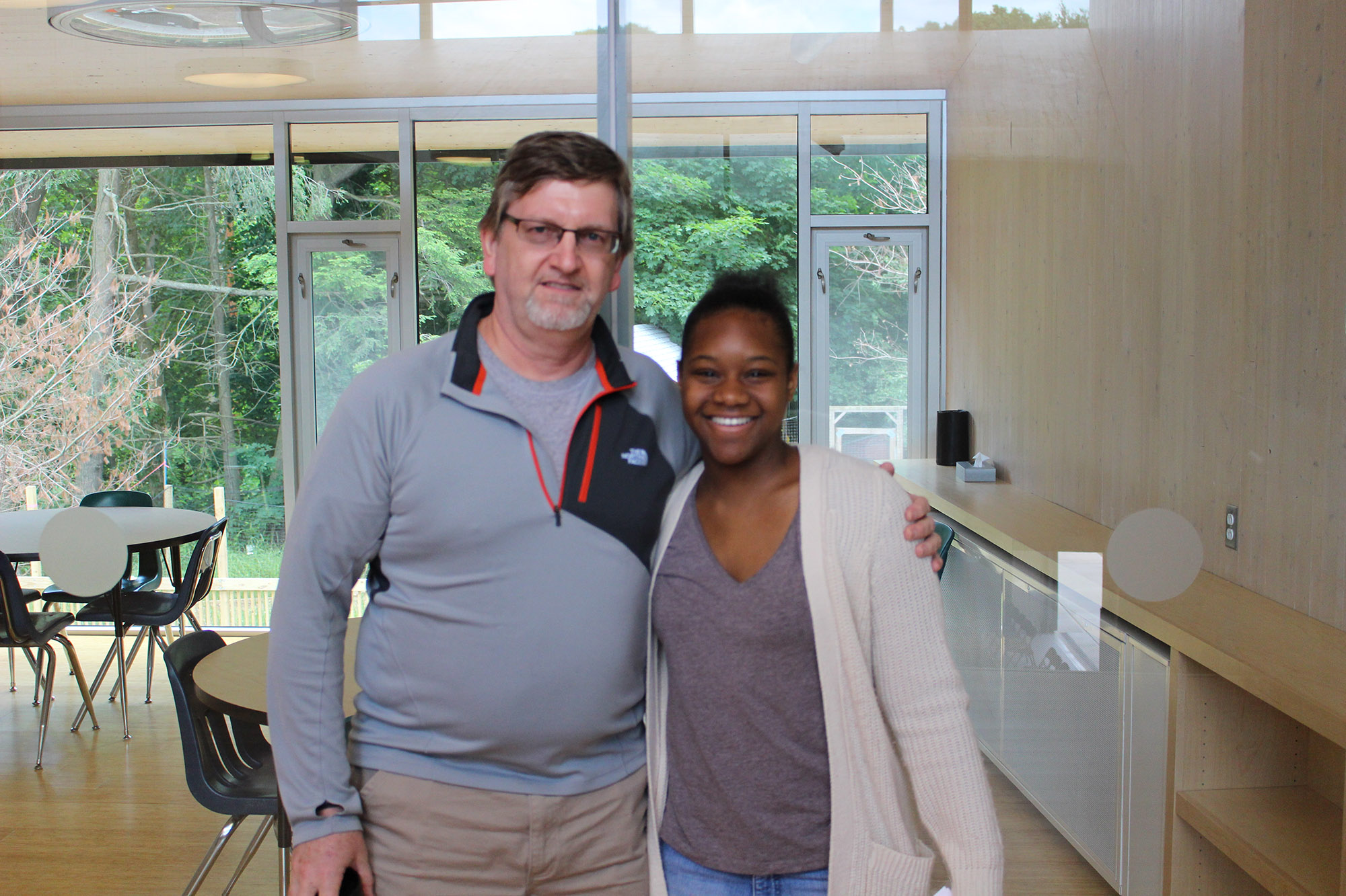 Taylor and Mr. Kelahan in Common Ground's new school building.
