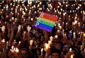 Supporters with candles at a vigil for the victims of Orlando Pulse shooting.