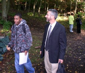 While still a student at Common Ground, Tyler talks with SCSU professor Andrew Smyth as part of college exploration program.