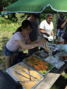 Huang Yi works with Common Ground's kitchen crew to prepare a lunch for other members of Common Ground's Green Jobs Corps and staff.